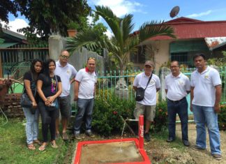 Putting Coca-Cola stickers to some tap stands in Brgy Catmon. Thank you Agos Foundation!! Photo from Ferdinand Morillo