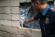 An element of the Naval Police team was investigating the window bars of the victim's room. They believed that this is where the alleged killer, Ronald Resallosa Santos gained unlawful entry. Photo from PNP Naval.