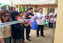 District Engineer David P. Adongay Jr. ( wearing white long sleeve ) lead the ceremonial cutting of ribbon together with Biliran Lone District Representative, Rogelio J. Espina (wearing blue polo shirt) and from Representatives of Department of Education (DepEd) - Biliran Division and NNHS School Heads.