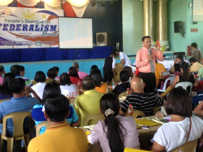 FEDERALISM. Atty. Cyril Casey G. Blanco (standing wearing peach colored long sleeves polo), legal officer, DILG Regional Office No. 8, extensively discussed the basic concepts of Federalism during the People's Dialogue on Federalism-Round 2 conducted by the DILG Biliran provincial office and the Philippine Councilors League in coordination with the League of Municipalities of the Philippines-Biliran Chapter. The forum is attended by some 500 participants composed of municipal mayors, vice-mayors, sangguniang bayan members, sangguniang bayan secretaries of the eight towns, punong barangays and kagawads of the 132 barangays in Biliran province, and several sectoral representatives held at the Naval State University (NSU) Gymnasium, Naval, Biliran, August 24, 2017.(rvictoria/PIA Biliran)