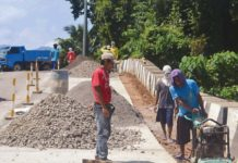 Double time – Workers of the Department of Public Works and Highways (DPWH) work on the widening of the Biliran Circumferential Road at a section of Biliran town in Biliran province. (Restituto A. Cayubit|Manila Bulletin)